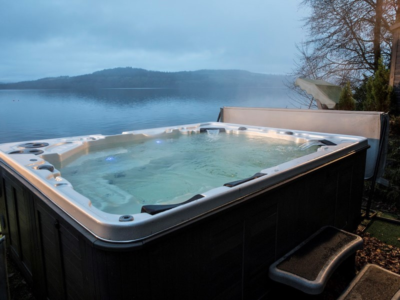 Waterside Self Catering Lodges and Cottages Overlooking Loch Lomond in Scotland with Hot Tub